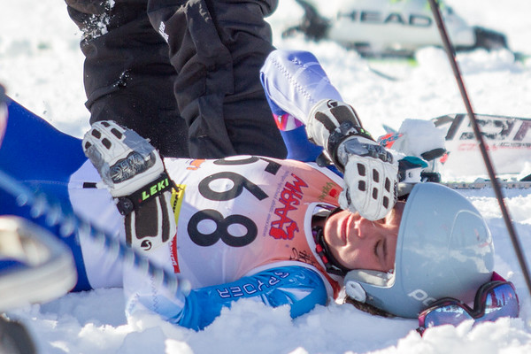 Record-Eagle/Brett A. Sommers Great North Alpine's Marina Ascione receives attention after a fall on the giant slalom course during Monday's MHSAA Division 2 ski finals.