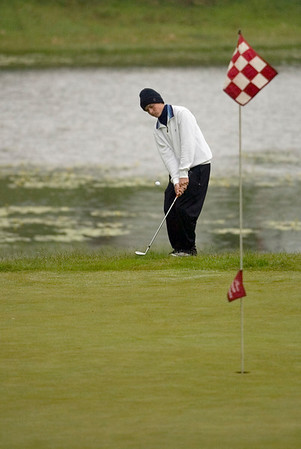 Record-Eagle/Jan-Michael Stump<br /> Traverse City St. Francis' Patrick Colburn chips onto the 7th green.