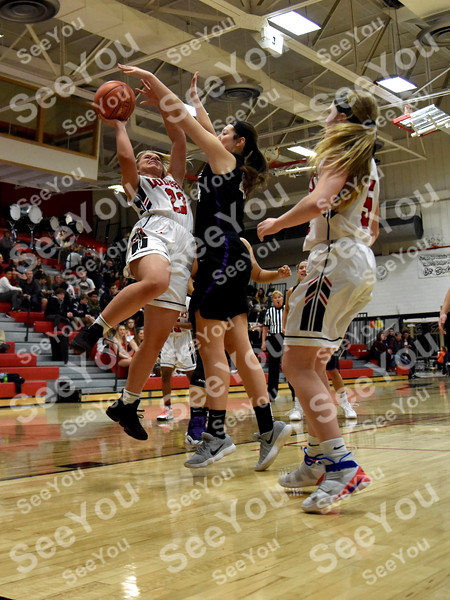 -Messenger photo by Britt Kudla<br /> Tristin Doster of Fort Dodge shoots around Waukee Paityn Rau on Friday inside Dodgers gym