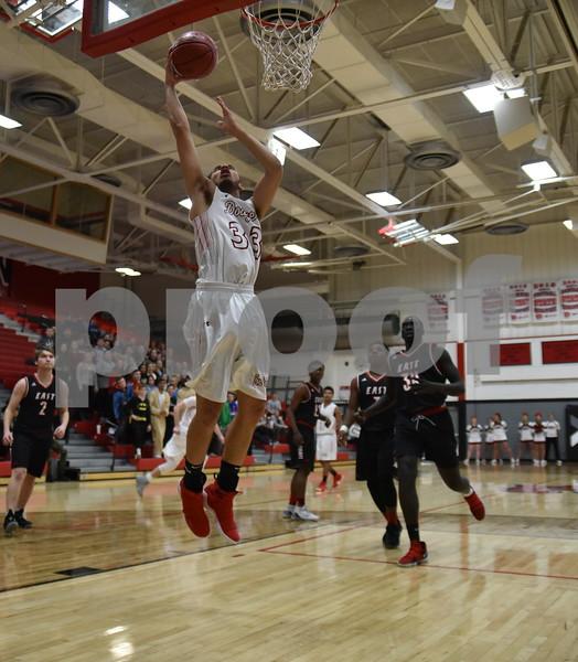 -Messenger photo by Britt Kudla<br /> Jordan Jackson of Fort Dodge put up a shot against Des Moines East during substate quarterfinals on Tuesday