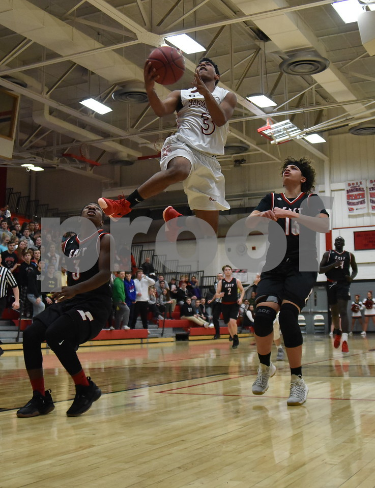 -Messenger photo by Britt Kudla<br /> Trey Mosley of Fort Dodge goes up for a shot against Des Moines East during substate quarterfinals on Tuesday