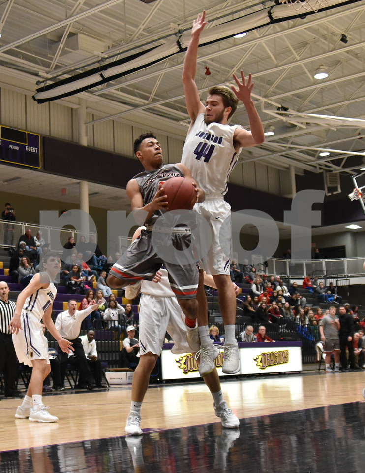 -Messenger photo by Britt Kudla<br /> Trey Mosley of Fort Dodge shoots around Johnston Nathan Newcomb during 4A substate semi-finals on Friday