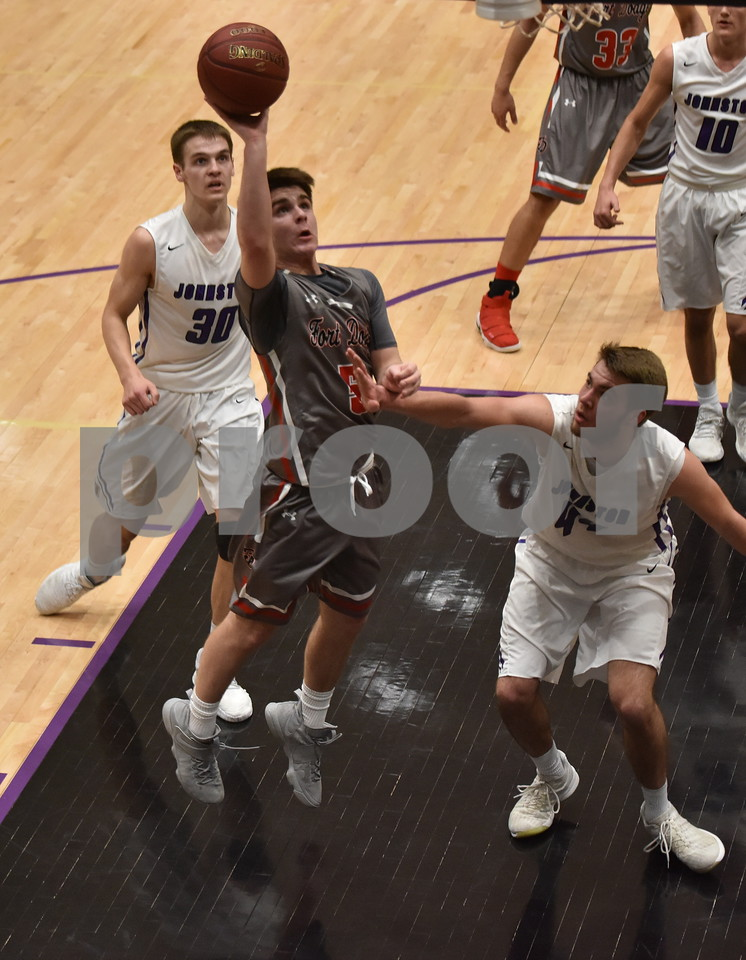 -Messenger photo by Britt Kudla<br /> Jace Peterson of Fort Dodge shoots over Johnston Nathan Newcomb during 4A substate semi-finals on Friday