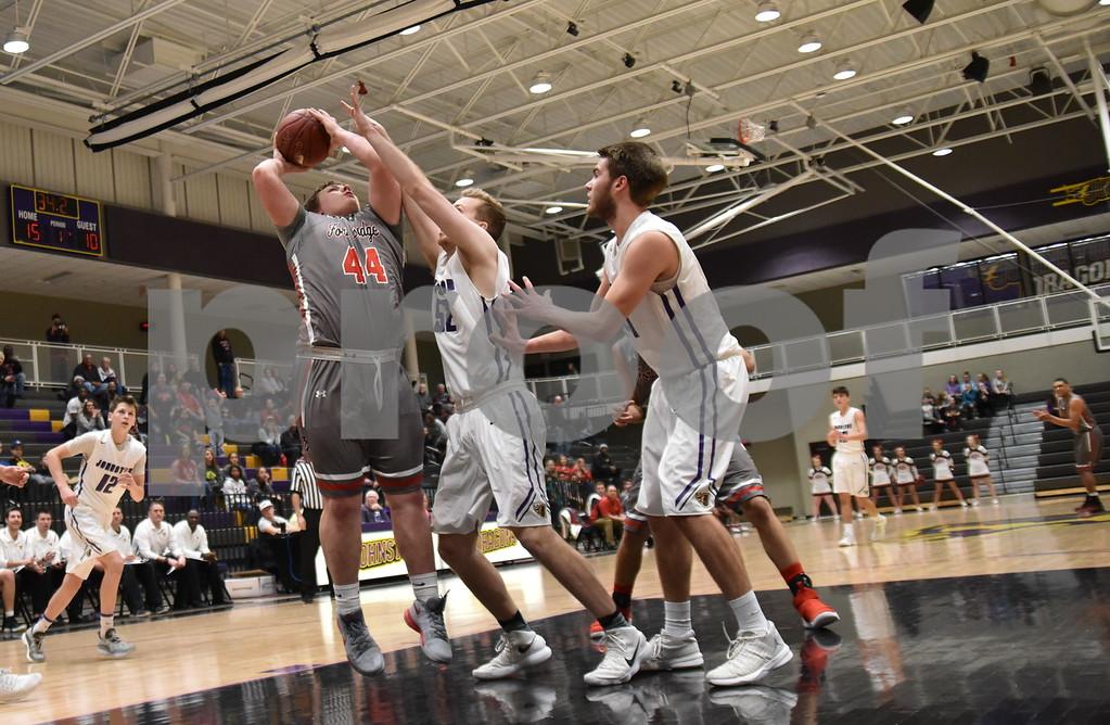 -Messenger photo by Britt Kudla<br /> Aaron Porter of Fort Dodge shoots over Johnston Chandler Heiser during 4A substate semi-finals on Friday