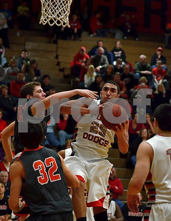 -Messenger photo by Britt Kudla<br /> Blake Wilder of Fort Dodge shoots over Ames (41) Michael Frankl during the 2nd half on Friday night inside Dodger gym