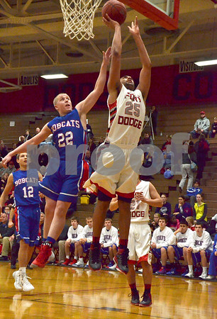 -Messenger photo by Britt Kudla<br /> Blake Wilder of Fort Dodge scores against Marshalltown on Friday inside Dodger gym