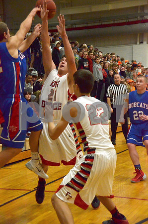 -Messenger photo by Britt Kudla<br /> Fort Dodge's Andrew Stover makes the block against Marshalltown on Friday