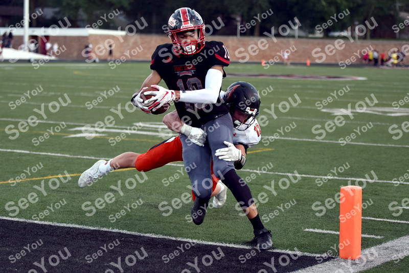 -Messenger photo by Britt Kudla<br /> Tysen Kershaw of Fort Dodge scores a touchdown against Ames on Friday inside Dodgers Stadium