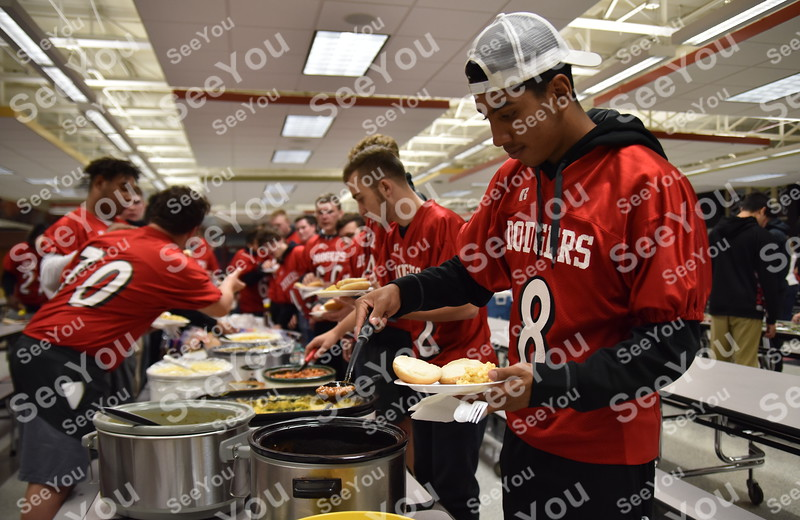 -Messenger photo by Britt Kudla<br /> Brycen Bell of Fort Dodge fill his plate with a home cook meal after Dodgers prep rally at Fort Dodge Senior High on Thursday