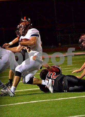 -Messenger photo by Britt Kudla<br /> Austin Halligan of Fort Dodge makes the tackles against Ankeny on Friday night at Dodger Stadium