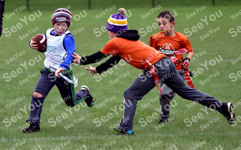 -Messenger photo by Britt Kudla<br /> Colton Hang (10U) of Southeast Valley runs around Manson Aiden Nelson on Saturday at Fort Frenzy