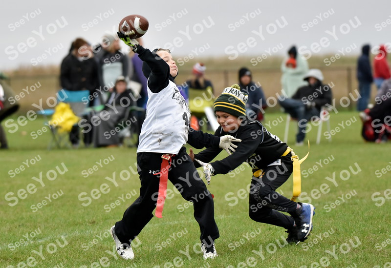 -Messenger photo by Britt Kudla<br /> Fort Dodge 10U Ace Grell attempts to sack Davis Underberg during Fort Frenzy Flag Football Tournament on Saturday