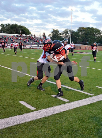 -Messenger photo by Britt Kudla<br /> Brandon Archibald of Fort Dodge makes the catch for a first down during Friday game against Mason City