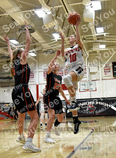 -Messenger photo by Britt Kudla<br /> Aleaha Pommer of Fort Dodge puts a up a shot against West Des Moines Valley on Friday