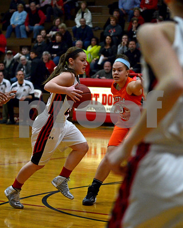 -Messenger photo by Britt Kudla<br /> Karianna Grindberg of Fort Dodge drives towards the basket against Ames' Bailee Jackson on Friday inside Dodger gym