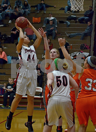 -Messenger photo by Britt Kudla<br /> Tina Mericle of Fort Dodge shoots inside the paint against Ames on Friday night game inside Dodger gym