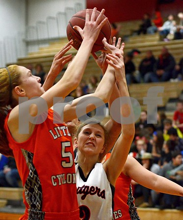 -Messenger photo by Britt Kudla<br /> Lexi Astor of Fort Dodge fights for the rebound against Ames' Ryan Weiss on Friday night inside Dodger's gym