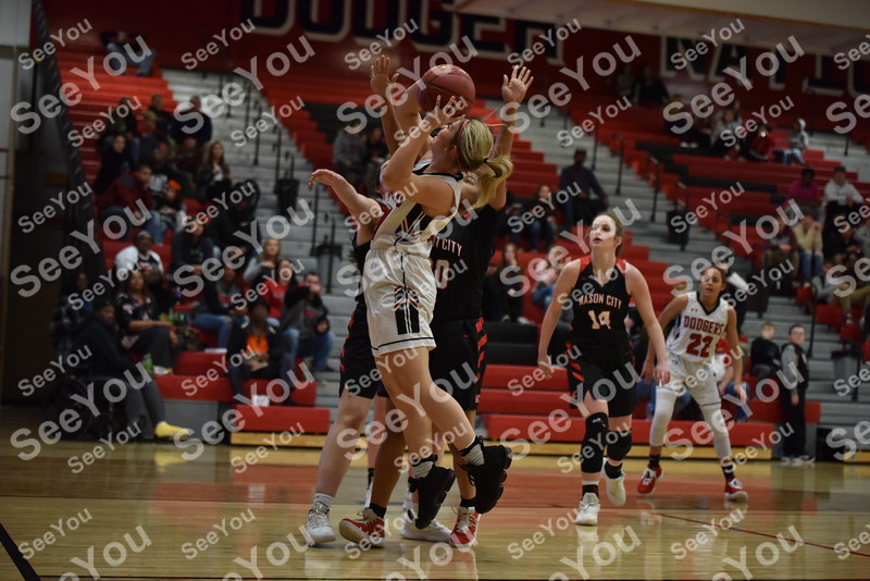-Messenger photo by Britt Kudla<br /> Tristin Doster of Fort Dodge goes up for a shot against Mason City on Friday