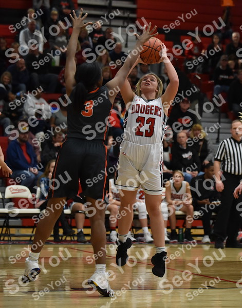-Messenger photo by Britt Kudla <br /> Tristin Doster of Fort Dodge shoots over Valley Zoe Young on Friday inside Dodgers gym