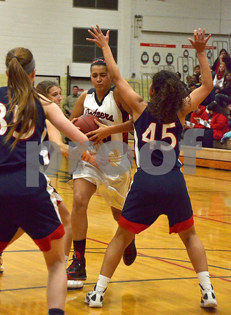 -Messenger photo by Britt Kudla<br /> Ashley Altman of Fort Dodge makes her way through Marshalltown defender for the score during Friday night game inside Dodger gym