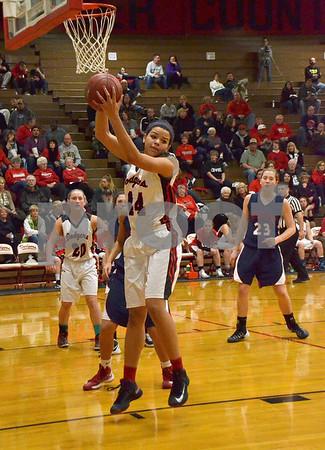 -Messenger photo by Britt Kudla<br /> Fort Dodge's Tiana Mericle rebounds against Marshalltown on Friday inside Dodger's gym