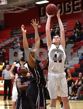-Messenger photo by Britt Kudla Kacee Gollob of Fort Dodge puts up a shot against Waterloo West on Saturday