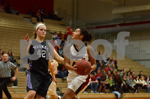 -Messenger photo by Britt Kudla<br /> Ashley Altman of Fort Dodge attempts a shot from inside the paint against Waukee on Tuesday