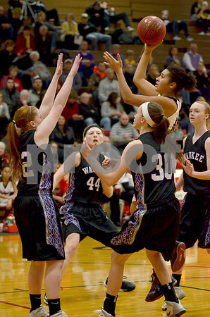 -Messenger photo by Britt Kudla<br /> Fort Dodge's Ashley Altman shoots from inside the paint against Waukee on Tuesday