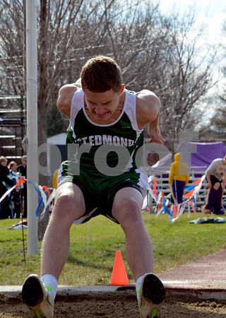 messenger photo by Britt Kudla<br />  Cory Angstrom of st. Edmond competes in Long Jump during the boy's relay at dodge stadium.