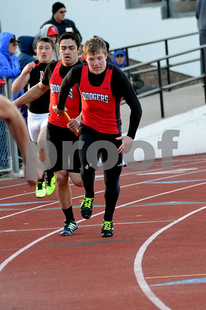 messenger photo by Britt Kudla<br /> Fort Dodge competes in the 4x200 meter relay during the boy's relay at Dodger Stadium on monday night.