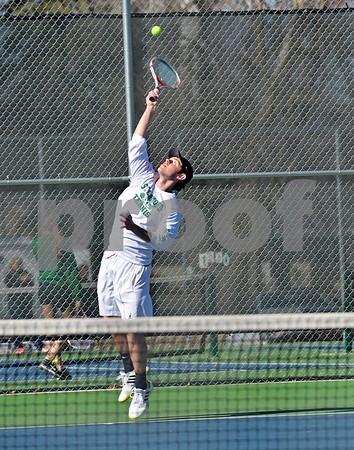 -Messenger photo by Britt Kudla<br /> St. Edmond's Konrad Laufersweiler serves against Fort Dodge on Tuesday at Dodger courts