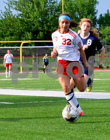 - Messenger photo by Britt Kudla<br /> Fort Dodge's Paige Savery brings the ball down the field on Wednesday against Sioux City North