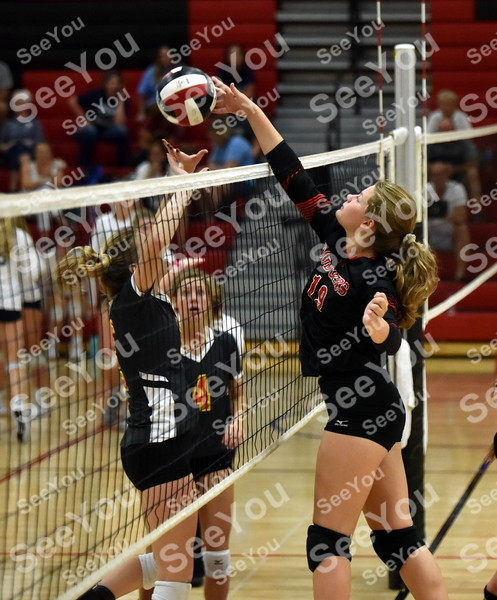 -Messenger photo by Britt Kudla<br /> Kiana Touney of Fort Dodge sends the ball over Ridge View during Dodgers Invitational on Saturday