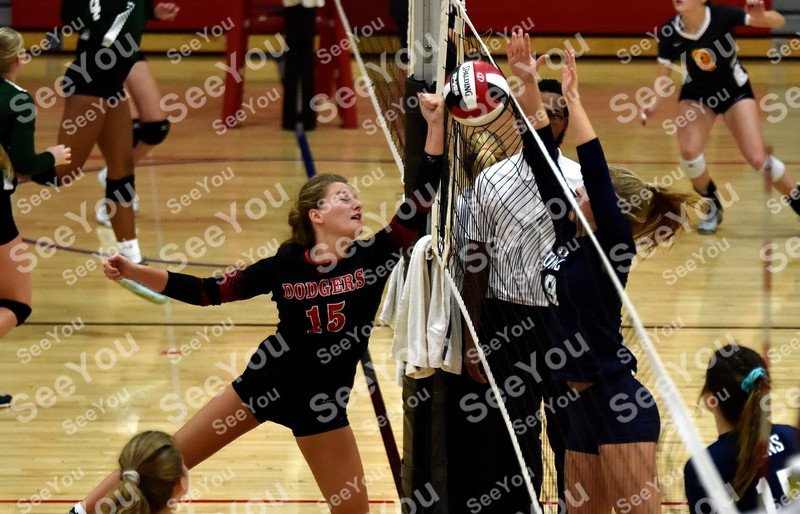 -Messenger photo by Britt Kudla<br /> Brooke Erickson of Fort Dodge punches the ball over Des Moines Christian during Dodgers Invitational on Saturday