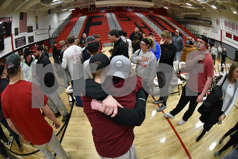 -Messenger photo by Britt Kudla<br /> Fort Dodge Cayd Lara gives assistant Coach Tanner Utley during Dodgers Welcome home rally on Sunday