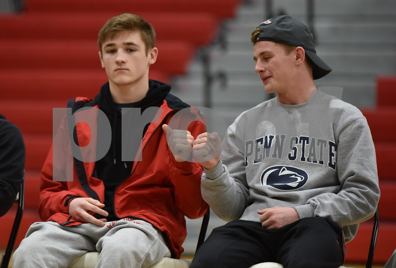 -Messenger photo by Britt Kudla<br /> Fort Dodge Drew Bennett (left) and Brody Teske fist bumps during the Dodger Welcome Home Rally on Sunday