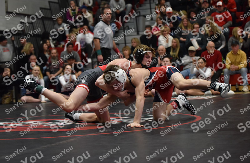 -Messenger photo by Britt Kudla<br /> Carson Taylor of Fort Dodge wrestles against Sioux City North Nick Walter in the finals during Class 3A District on Saturday