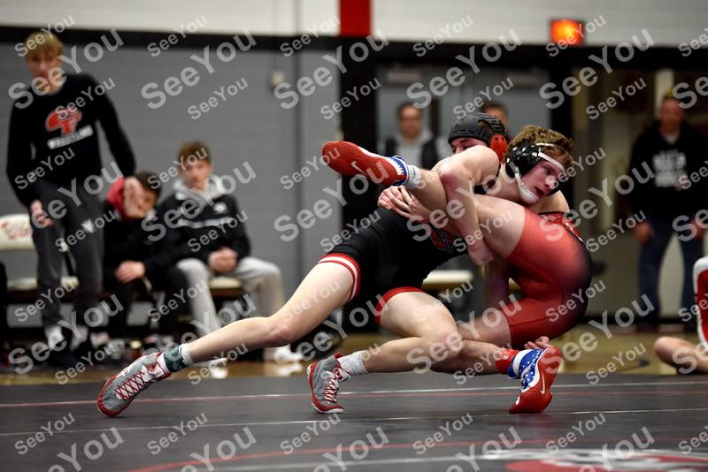 -Messenger photo by Britt Kudla<br /> Brandon Mills of Fort Dodge wrestles against Cedar Falls Austin Cross during class 3A Region Duals on Wednesday