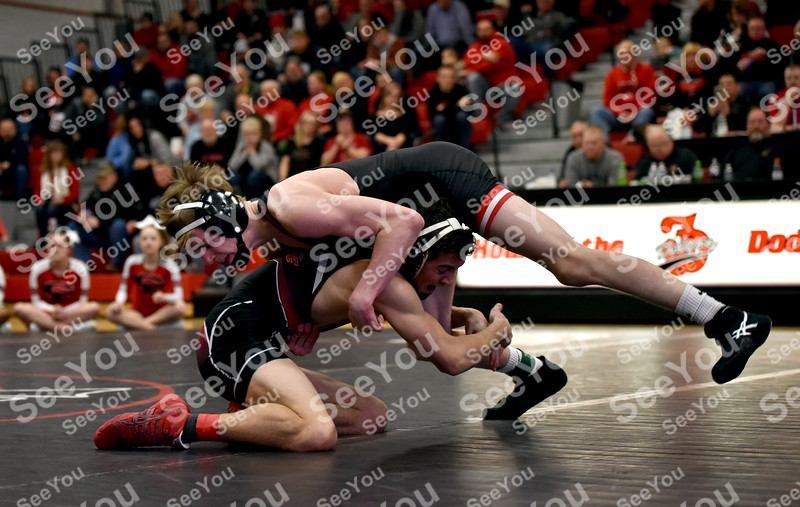 -Messenger photo by Britt Kudla Carson Taylor of Fort Dodge wrestles against Cedar Falls Jakey Penrith on Wednesday