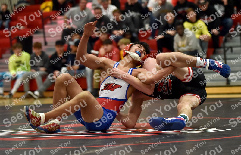 -Messenger photo by Britt Kudla<br /> Zach Bitker of Marshalltown wrestles against Fort Dodge Brooks Cowell on Thursday inside Dodgers gym