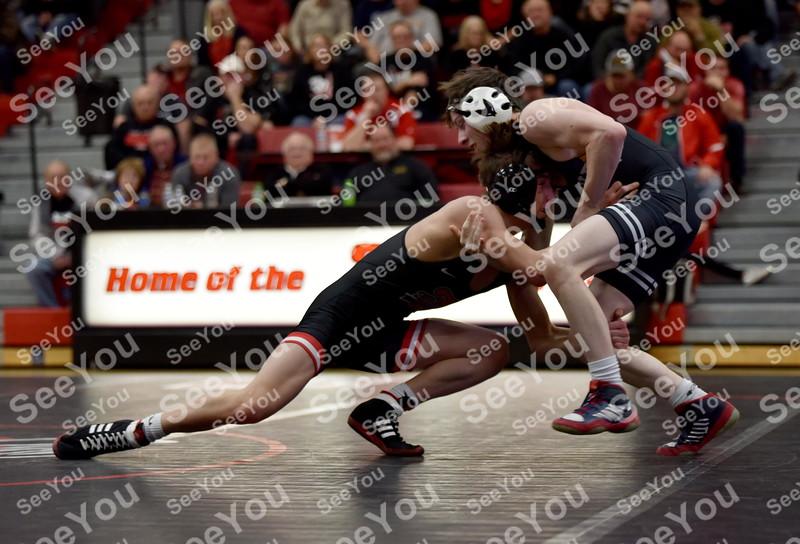 -Messenger photo by Britt Kudla<br /> Drake Ayala of Fort Dodge wrestles against Waukee Thurman Christensen on Thursday