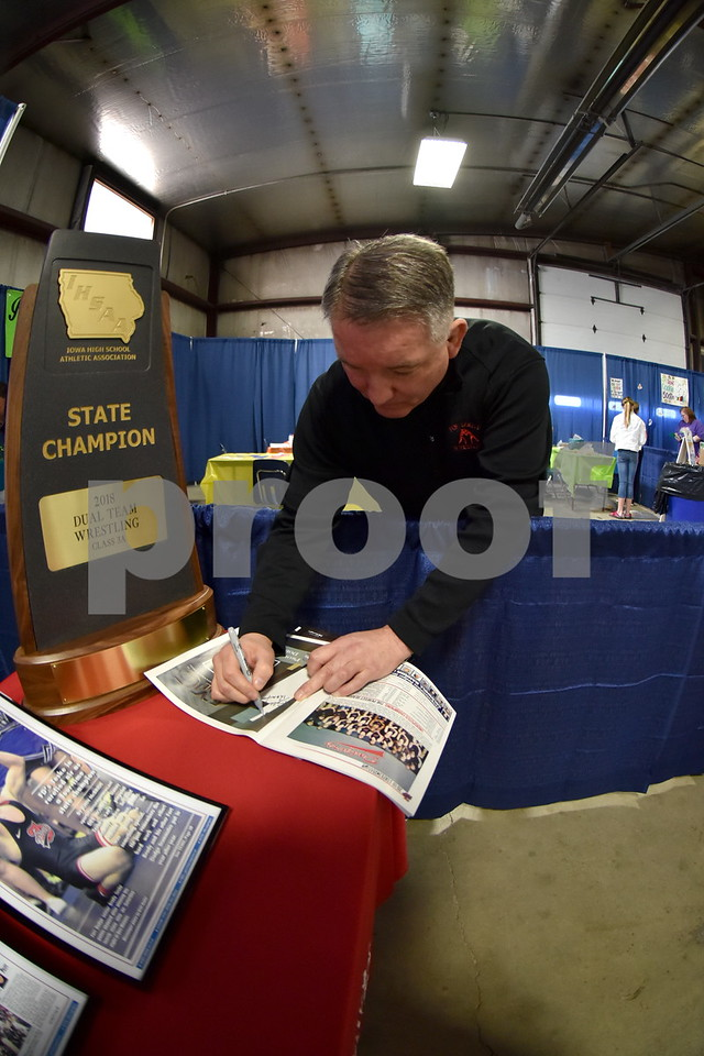 -Messenger photo by Britt Kudla<br /> Fort Dodge Head Wrestling Coach Bobby Thompson autograph The Dodgers Championship keepsake magazine at the Home and Lifestyle Show on Saturday