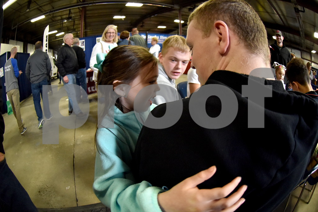 -Messenger photo by Britt Kudla<br /> Fort Dodge Madi Smith (6 years old) gives her older brother Kaden Smith tap on the shoulder during the Home and Lifestyle Show on Saturday