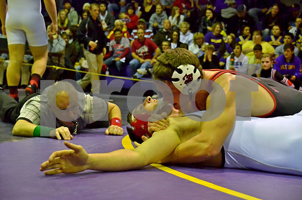 -Messenger photo by Britt Kudla<br /> Sam Cook of Fort Dodge pins Clarion-goldfield's Ryan Anderson on Saturday during the 2013 Eagle Grove Invitational