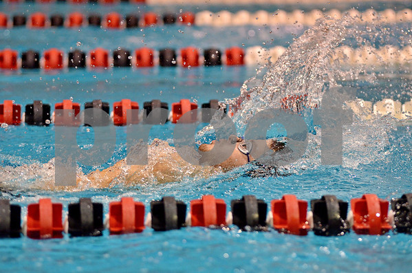 -Messenger photo by Britt Kudla<br /> Zach Provin of Fort Dodge competes in the 100 yard backstroke on Thursday against Waukee