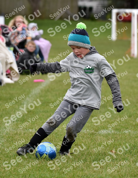 -Messenger photo by Britt Kudla<br /> Brody Evans of Fort Dodge (6U) dribbles down the field during Rogers Park soccer Tournament on Saturday