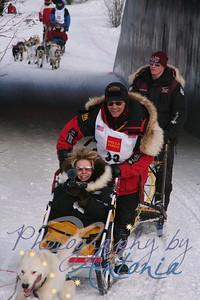 Bib #33 - 2004 Iditarod Champion - Mitch Seavey  (Iditarod Veteran Dallas Seavey is on the brake sled)