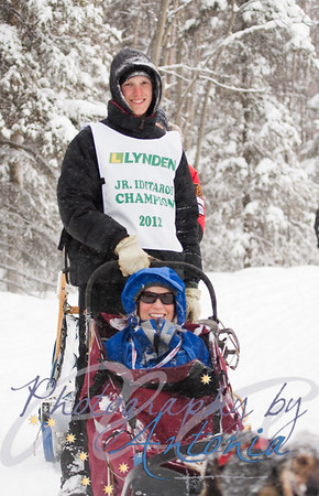 Junior Iditarod Champion Conway Seavey at the Tudor Crossing of the Ceremonial Start of the Iditarod. March 3, 2012