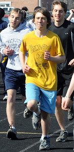 Don Henderson runs laps with the North Ridgeville track team Mar. 30.    Steve Manheim