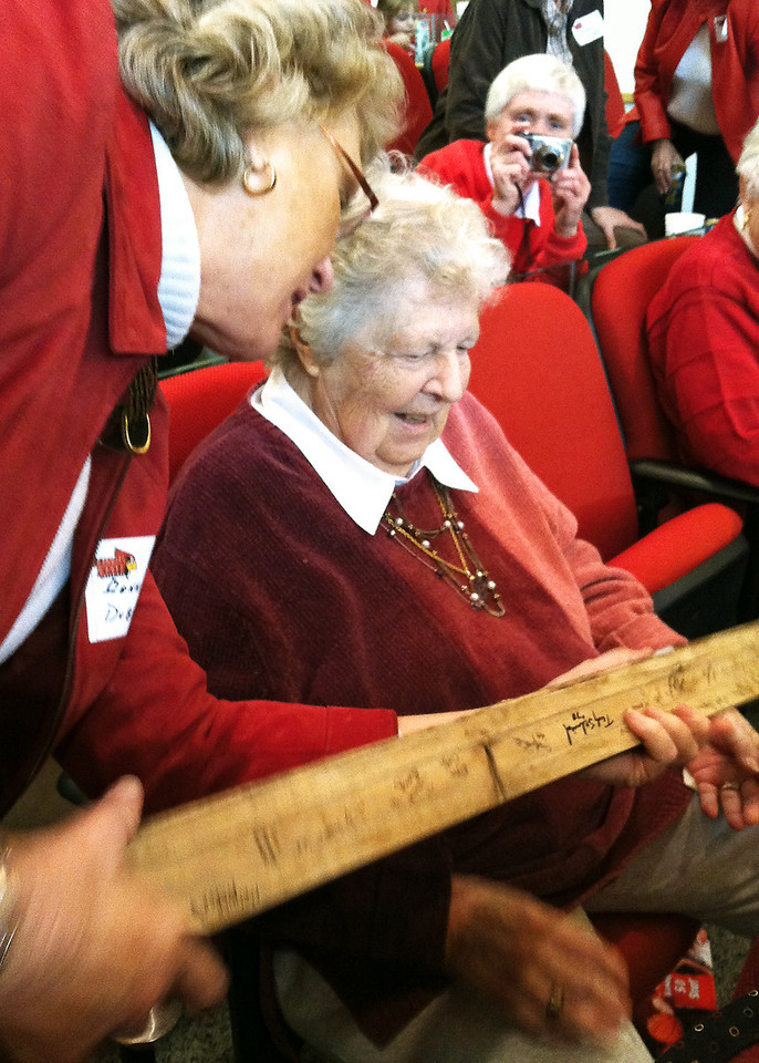Donna Dubblede presented a piece of McCormick Hall gym floor, which contained many signatures of former athletes, friends and colleagues.